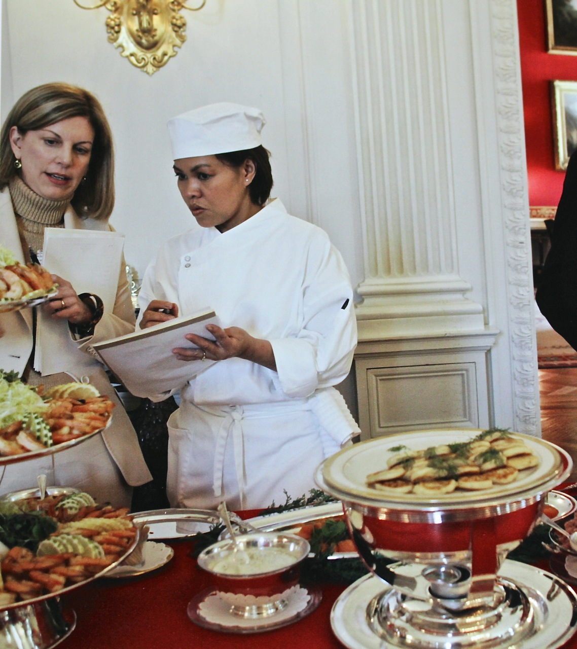 Caption: Cris and Lea Berman reviewing notes at a tasting for a White House Christmas buffet in 2005