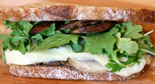 Gruyere with Baby Arugula, Sauteed Mushrooms on Pain de Campagne