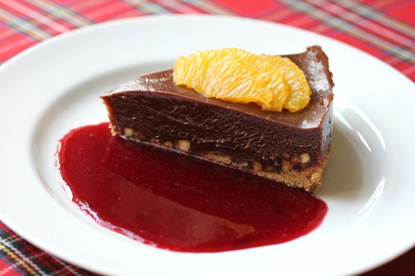 Laura Bush's Beef Tenderloin - Pecan Chocolate Tart Slice with Berry Sauce