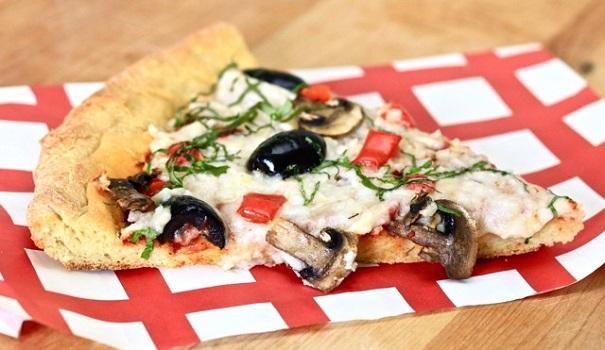 Olives, basil, mozzarella cheese on a gluten free crust