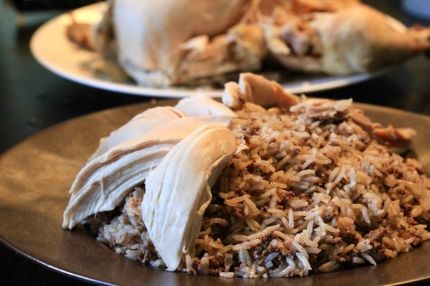 Lebanese Stuffed Rice and Chicken arranging the dish on Americas-Table.com