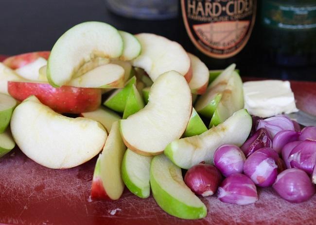 Pork loin, salt, pepper, butter, shallots, apples, flour, garlic, hard cider, & caraway seed