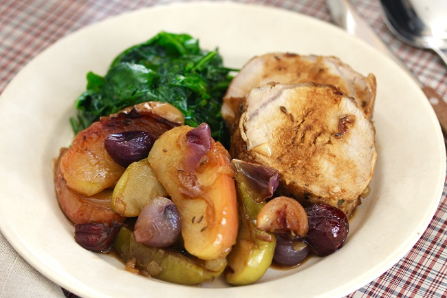 Transfer shallots and apples to a serving platter. Pour rest of pan juices into a small saucepan and reduce by half. Slice pork loin into thin slices and arrange on top of apples and shallots. Pour pan juices over pork, garnish with caraway seed, and serve.