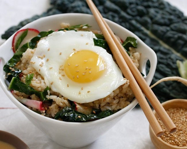BROWN RICE BOWL WITH KALE-RADISH SLAW, SOY, AND FRIED EGG